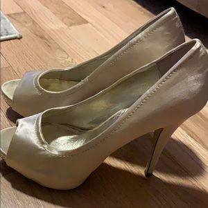 Platinum peep toe heels